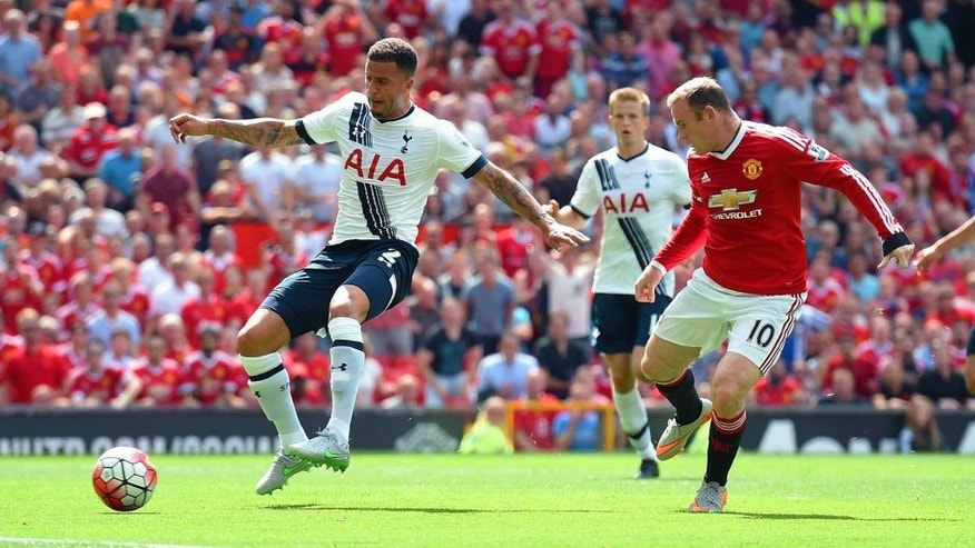 MANCHESTER, ENGLAND - AUGUST 08: Kyle Walker (L) of Tottenham Hotspur kicks the ball resulting in the own goal during the Barclays Premier League match between Manchester United and Tottenham Hotspur at Old Trafford on August 8, 2015 in Manchester, England. (Photo by Michael Regan/Getty Images)