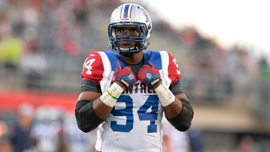 Aug. 7, 2015: Montreal Alouettes' Michael Sam is set to make his pro football debut as he warms up before the first half of a Canadian Football League game against the Ottawa Redblacks in Ottawa, Ontario.