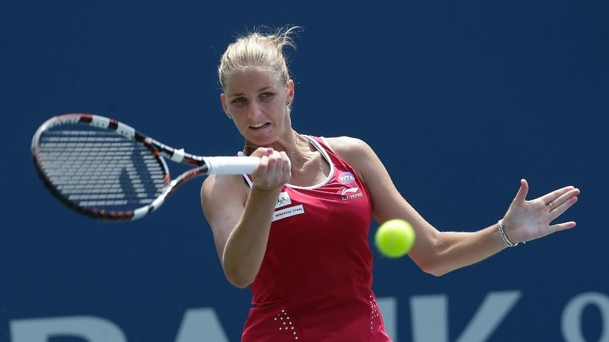 Karolina Pliskova, from Czech Republic, returns the ball to Varvara Lepchenko during a semifinal in the Bank of the West Classic tennis tournament in Stanford, Calif., Saturday, Aug. 8, 2015. (AP Photo/Jeff Chiu)