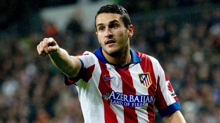 MADRID, SPAIN - JANUARY 15: Koke of Atletico de Madrid gives instructions to thier teammates during the Copa del Rey Round of 16 second leg match between Real Madrid CF and Club Atletico de Madrid at Estadio Santiago Bernabeu on January 15, 2015 in Madrid, Spain. (Photo by Gonzalo Arroyo Moreno/Getty Images)