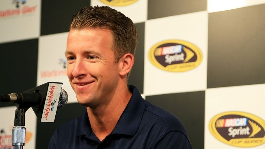 WATKINS GLEN, NY - AUGUST 07: AJ Allmendinger, driver of the #47 Kroger/Bush's Beans Chevrolet, speaks to the media during a press conference prior to practice for the NASCAR Sprint Cup Series Cheez-It 355 at Watkins Glen International on August 7, 2015 in Watkins Glen, New York. (Photo by Daniel Shirey/Getty Images)