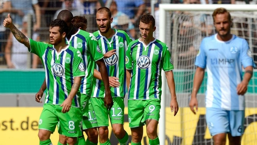 STUTTGART, GERMANY - AUGUST 09: Bas Dost of Wolfsburg (C) celebrates his team's second goal with team mates during the DFB Cup First Round match between Stuttgarter Kickers and VfL Wolfsburg at GAZI-Stadion on August 9, 2015 in Stuttgart, Germany. (Photo by Daniel Kopatsch/Bongarts/Getty Images)