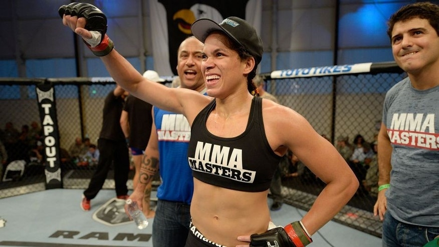 FORT CAMPBELL, KENTUCKY - NOVEMBER 6: Amanda Nunez celebrates after defeating Germaine de Randamie in their UFC women's bantamweight bout on November 6, 2013 in Fort Campbell, Kentucky. (Photo by Jeff Bottari/Zuffa LLC/Zuffa LLC via Getty Images) *** Local Caption ***Amanda Nunes