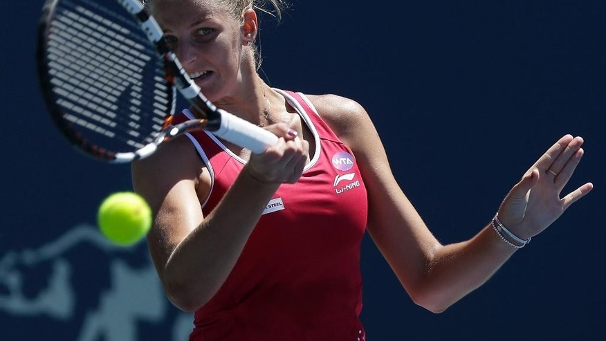 Karolina Pliskova, from Czech Republic, returns the ball to Angelique Kerber, from Germany, during the championship match in the Bank of the West Classic tennis tournament in Stanford, Calif., Sunday, Aug. 9, 2015. (AP Photo/Jeff Chiu)