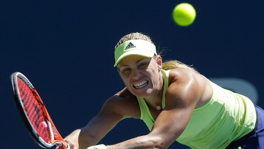 Angelique Kerber, from Germany, returns the ball to Karolina Pliskova, from Czech Republic, during the championship match in the Bank of the West Classic tennis tournament in Stanford, Calif., Sunday, Aug. 9, 2015. Kerber won 6-3, 5-7, 6-4. (AP Photo/Jeff Chiu)