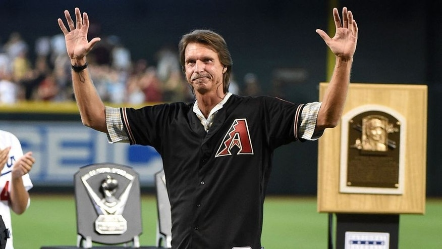 PHOENIX, AZ - AUGUST 08: Former Arizona Diamondbacks pitcher Randy Johnson #51 waves to the fans prior to a game against the Cincinnati Reds at Chase Field on August 8, 2015 in Phoenix, Arizona. The Arizona Diamondbacks retired his number #51 during a pregame ceremony. (Photo by Norm Hall/Getty Images)