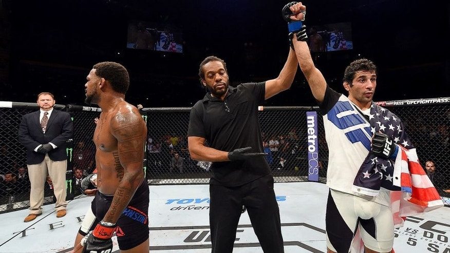 NASHVILLE, TN - AUGUST 08: (R-L) Beneil Dariush celebrates after defeating Michael Johnson in their lightweight bout during the UFC Fight Night event at Bridgestone Arena on August 8, 2015 in Nashville, Tennessee. (Photo by Josh Hedges/Zuffa LLC/Zuffa LLC via Getty Images)