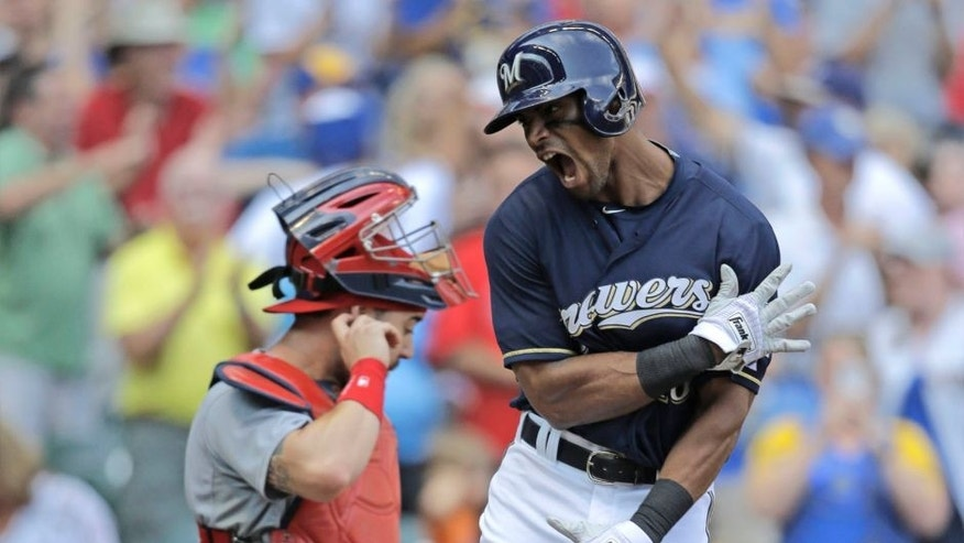 The Milwaukee Brewers' Khris Davis crosses the plate after his two-run home run against the St. Louis Cardinals in the eighth inning Sunday, Aug. 9, 2015, in Milwaukee.