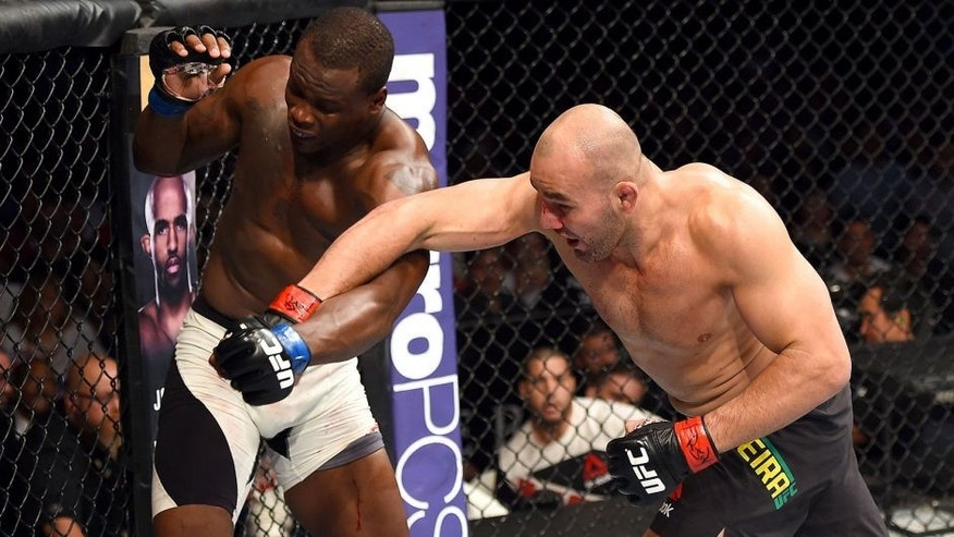NASHVILLE, TN - AUGUST 08: (R-L) Glover Teixeira of Brazil punches Ovince Saint Preux in their light heavyweight bout during the UFC Fight Night event at Bridgestone Arena on August 8, 2015 in Nashville, Tennessee. (Photo by Josh Hedges/Zuffa LLC/Zuffa LLC via Getty Images)