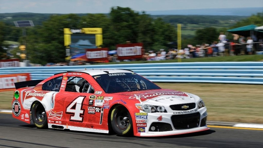 Kevin Harvick (4) drives during a NASCAR Sprint Cup series auto race at Watkins Glen International, Sunday, Aug. 9, 2015, in Watkins Glen, N.Y. (AP Photo/Mel Evans)