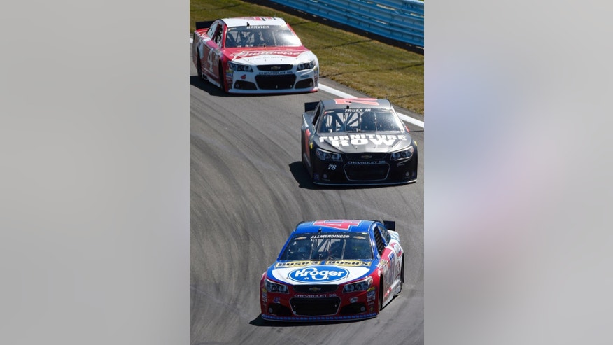 AJ Allmendinger (47) leads Martin Truex Jr. (78) and Kevin Harvick (4) into Turn 1 during a NASCAR Sprint Cup series auto race at Watkins Glen International, Sunday, Aug. 9, 2015, in Watkins Glen. N.Y. (AP Photo/Derik Hamilton)