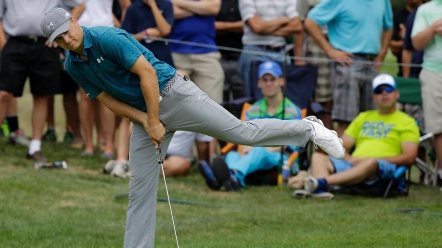 Jordan Spieth reacts after missing a putt for par on the seventh hole during the final round of the Bridgestone Invitational golf tournament at Firestone Country Club, Sunday, Aug. 9, 2015, in Akron, Ohio. Spieth bogeyed the hole. (AP Photo/Tony Dejak)
