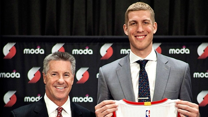 PORTLAND, OR - JUNE 29: Mason Plumlee #24 of the Portland Trail Blazers is introduced by GM Neil Oshay and head coach Terry Stotts during a press conference on June 29, 2015 at the practice facility in Portland, Oregon. NOTE TO USER: User expressly acknowledges and agrees that, by downloading and or using this photograph, User is consenting to the terms and conditions of the Getty Images License Agreement. Mandatory Copyright Notice: Copyright 2015 NBAE (Photo by Cameron Browne/NBAE via Getty Images)