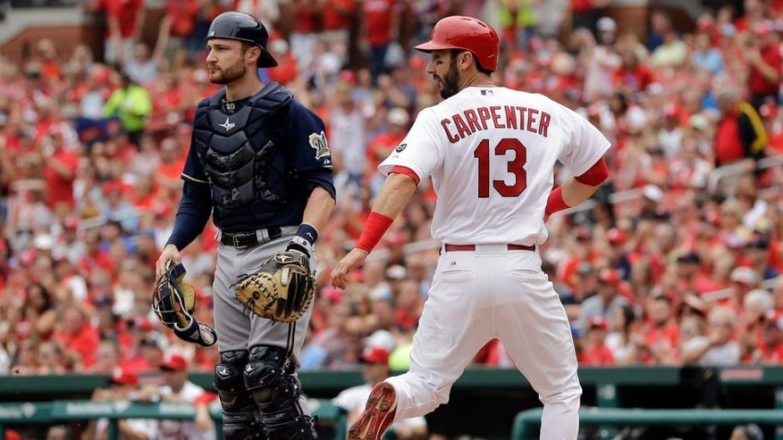 <p>St. Louis Cardinals' Matt Carpenter, right, scores past Milwaukee Brewers catcher Jonathan Lucroy on an RBI single by Randal Grichuk during the first inning of a baseball game, Wednesday, June 3, 2015, in St. Louis. (AP Photo/Jeff Roberson)</p>