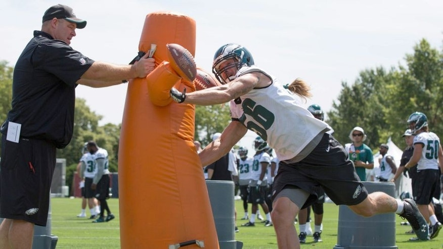 Aug 2, 2015; Philadelphia, PA, USA; Philadelphia Eagles linebacker Bryan Braman (56) attacks a tackling obstacle during training camp at NovaCare Complex. Mandatory Credit: Bill Streicher-USA TODAY Sports