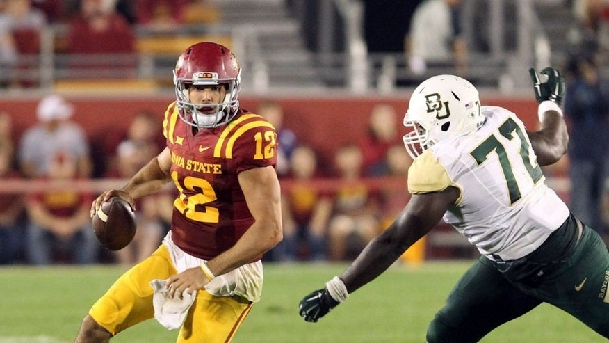 Sep 27, 2014; Ames, IA, USA; Iowa State Cyclones quarterback Sam B. Richardson (12) is chased down by Baylor Bears linesman Andrew Billings (72) at Jack Trice Stadium. Baylor beat the Cyclones 49-28. Mandatory Credit: Reese Strickland-USA TODAY Sports