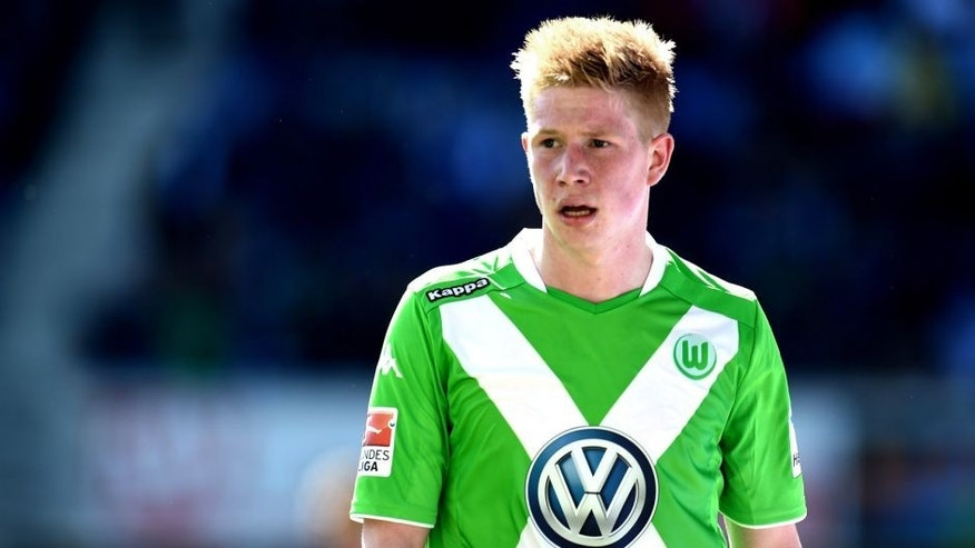 Wolfsburg's Belgian midfielder Kevin De Bruyne reacts during the German first division Bundesliga football match of SC Paderborn 07 vs VfL Wolfsburg in Paderborn, western Germany on May 10, 2015. AFP PHOTO / PATRIK STOLLARZ RESTRICTIONS - DFL RULES TO LIMIT THE ONLINE USAGE DURING MATCH TIME TO 15 PICTURES PER MATCH. IMAGE SEQUENCES TO SIMULATE VIDEO IS NOT ALLOWED AT ANY TIME. FOR FURTHER QUERIES PLEASE CONTACT DFL DIRECTLY AT + 49 69 650050. (Photo credit should read PATRIK STOLLARZ/AFP/Getty Images)