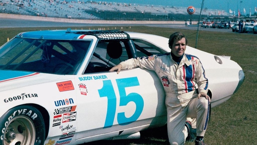 FILE - This is a 1975, file photo showing race car driver Buddy Baker at Daytona Speedway in Daytona Beach, Fla. Buddy Baker, a former Daytona 500 winner and NASCAR Hall of Fame nominee, has died after a brief battle with lung cancer. Baker was 74. SiriusXM NASCAR Radio announced Baker passed away early Monday morning, Aug. 10, 2015.  (AP Photo/File)