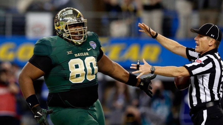 Jan 1, 2015; Arlington, TX, USA; Baylor Bears running back Cal Spangler (80) celebrates scoring a touchdown in the third quarter agains the Michigan State Spartans in the 2015 Cotton Bowl Classic at AT&T Stadium. Michigan State beat Baylor 42-41. Mandatory Credit: Tim Heitman-USA TODAY Sports