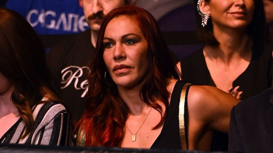 PHOENIX, AZ - DECEMBER 13: Cristiane 'Cyborg' Justino sits Octagonside during the UFC Fight Night event at the U.S. Airways Center on December 13, 2014 in Phoenix, Arizona. (Photo by Josh Hedges/Zuffa LLC/Zuffa LLC via Getty Images)
