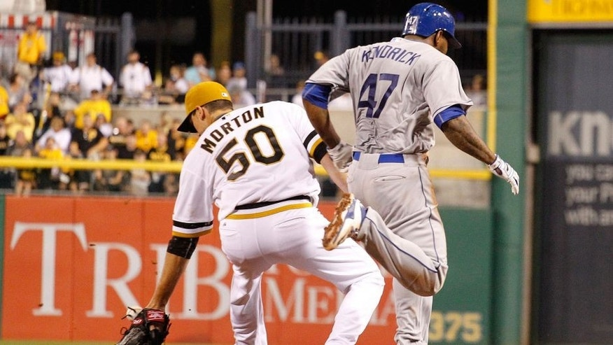 Aug 9, 2015; Pittsburgh, PA, USA; Los Angeles Dodgers second baseman Howie Kendrick (47) beats out an infield single against Pittsburgh Pirates starting pitcher Charlie Morton (50) during the fifth inning at PNC Park. Kendrick left the game after the play. Mandatory Credit: Charles LeClaire-USA TODAY Sports