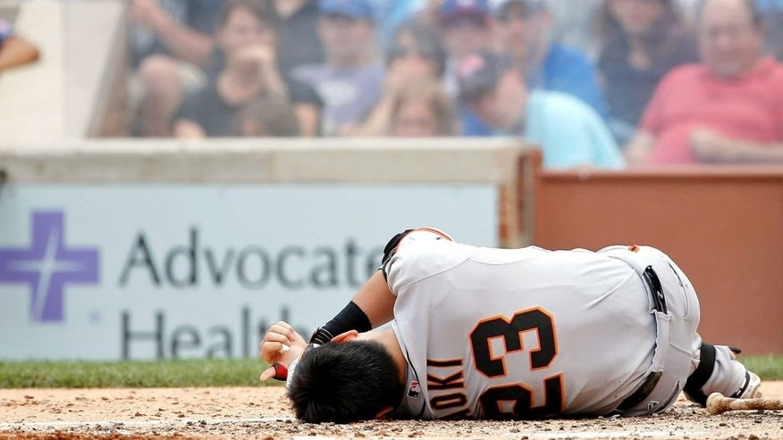 CHICAGO, IL - AUGUST 09: Nori Aoki #23 of the San Francisco Giants reacts after being hit in the head by a pitch thrown by Jake Arrieta #49 of the Chicago Cubs (not pictured) at Wrigley Field on August 9, 2015 in Chicago, Illinois. (Photo by Jon Durr/Getty Images)