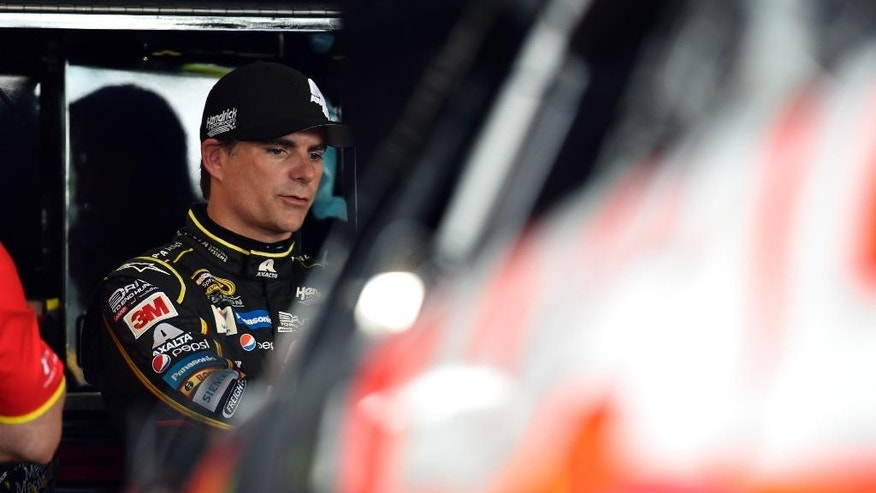 Jeff Gordon stands in the garage area during practice for Sunday's NASCAR Sprint Cup series auto race at Watkins Glen International, Friday, Aug. 7, 2015, in Watkins Glen, N.Y. (AP Photo/Derik Hamilton)