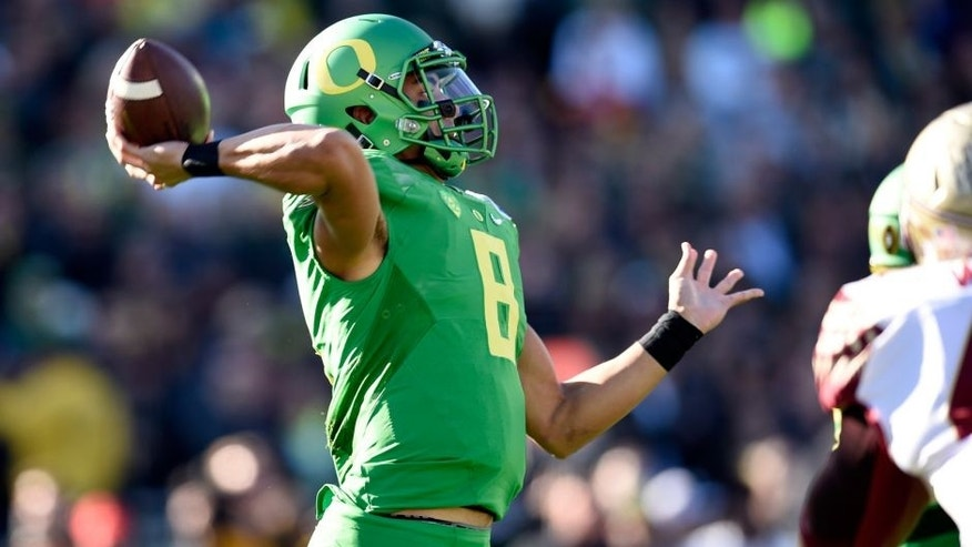 Jan 1, 2015; Pasadena, CA, USA; Oregon Ducks quarterback Marcus Mariota (8) passes against the Florida State Seminoles in the 2015 Rose Bowl college football game at Rose Bowl. Mandatory Credit: Kelvin Kuo-USA TODAY Sports