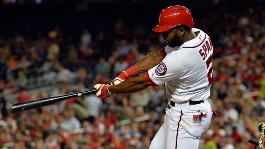 May 20, 2014; Washington, DC, USA; Washington Nationals center fielder Denard Span (2) singles in the sixth inning against the Cincinnati Reds at Nationals Park. Washington Nationals defeated Cincinnati Reds 9-4. Mandatory Credit: Tommy Gilligan-USA TODAY Sports