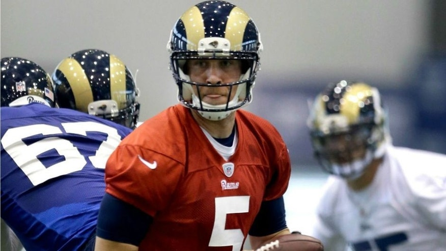 St. Louis Rams quarterback Nick Foles drops back to pass during an NFL football organized team activity, Thursday, June 4, 2015, in St. Louis. (AP Photo/Jeff Roberson)