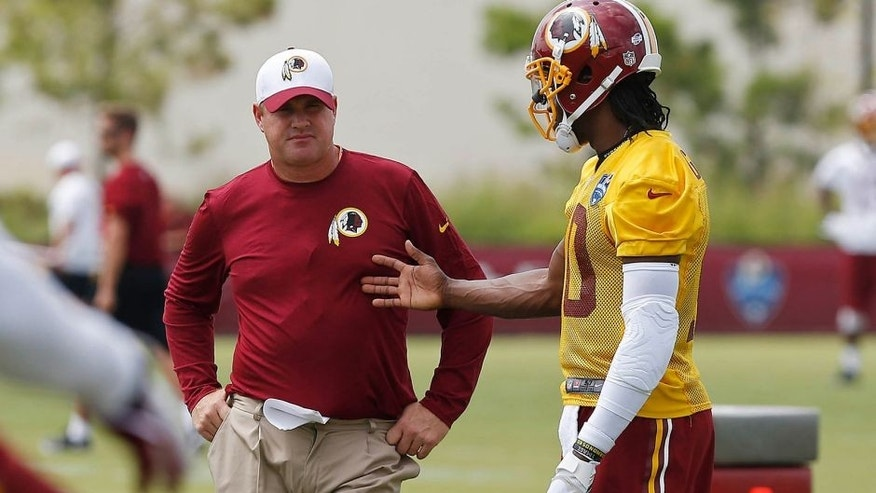 Jul 30, 2015; Richmond, VA, USA; Washington Redskins head coach Jay Gruden (L) talks with Redskins quarterback Robert Griffin III (10) during afternoon practice on day one of training camp at the Washington Redskins Bon Secours Training Center. Mandatory Credit: Geoff Burke-USA TODAY Sports