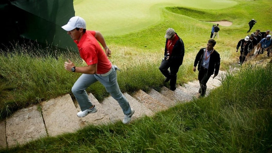 Rory McIlroy, of Northern Ireland, walks off the18th green after a practice round for the PGA Championship golf tournament at Whistling Straits Golf Course on Monday, Aug. 10, 2015 in Haven, Wis. (AP Photo/Chris Carlson)