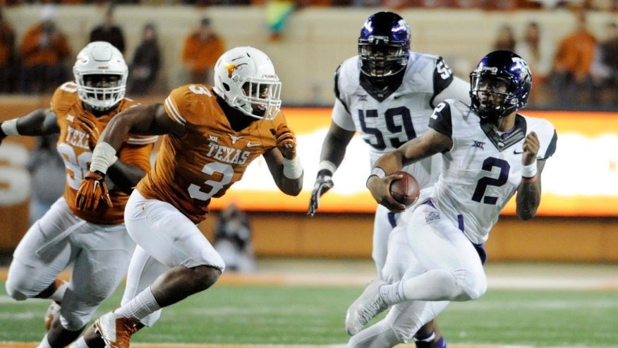 Nov 27, 2014; Austin, TX, USA; TCU Horned Frogs quarterback Trevone Boykin (2) scrambles away from Texas Longhorns linebacker Jordan Hicks (3) during the game at Darrell K Royal-Texas Memorial Stadium. Mandatory Credit: Brendan Maloney-USA TODAY Sports