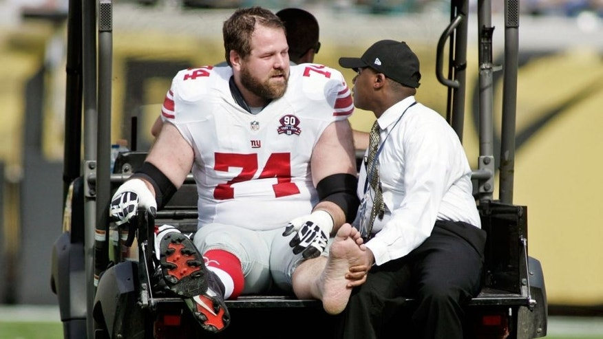 Nov 30, 2014; Jacksonville, FL, USA; New York Giants guard Geoff Schwartz (74) is carted off the field after being injured in the first quarter against the Jacksonville Jaguars at EverBank Field. Mandatory Credit: Phil Sears-USA TODAY Sports