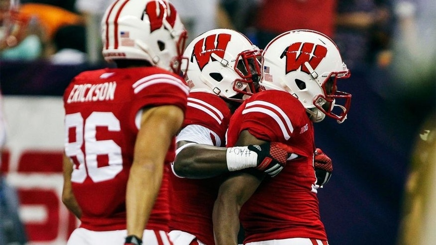 Aug 30, 2014; Houston, TX, USA; Wisconsin Badgers wide receiver Reggie Love (16) is congratulated after scoring a touchdown during the first quarter against the LSU Tigers at NRG Stadium. Mandatory Credit: Troy Taormina-USA TODAY Sports