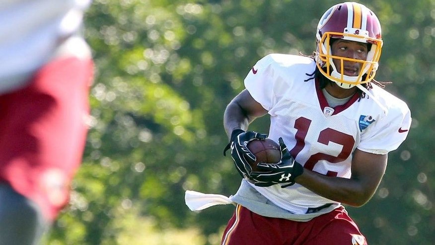Jul 24, 2014; Richmond, VA, USA; Washington Redskins wide receiver Andre Roberts (12) catches the ball during practice on day two of training camp at Bon Secours Washington Redskins Training Center. Mandatory Credit: Geoff Burke-USA TODAY Sports