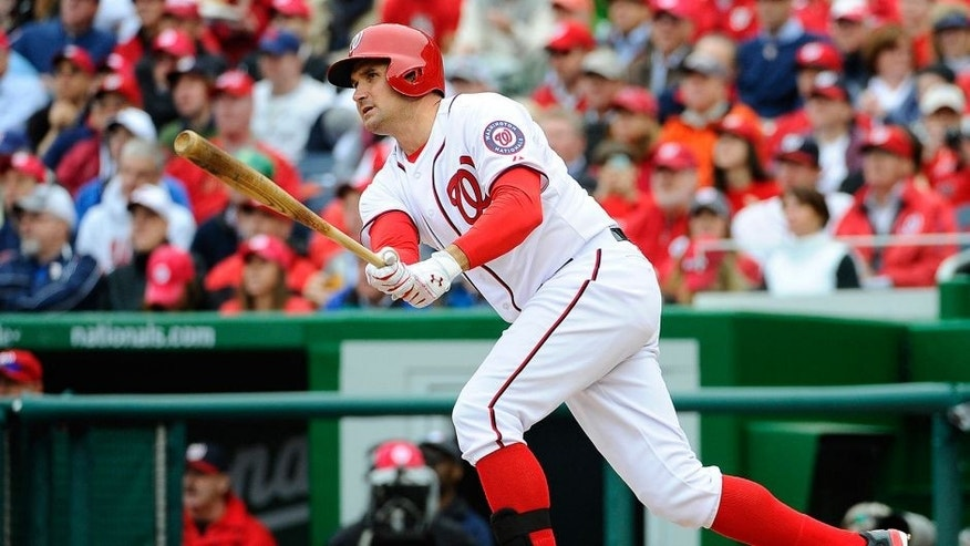 Apr 4, 2014; Washington, DC, USA; Washington Nationals third baseman Ryan Zimmerman (11) doubles against the Atlanta Braves during the fourth inning at Nationals Park. Mandatory Credit: Brad Mills-USA TODAY Sports