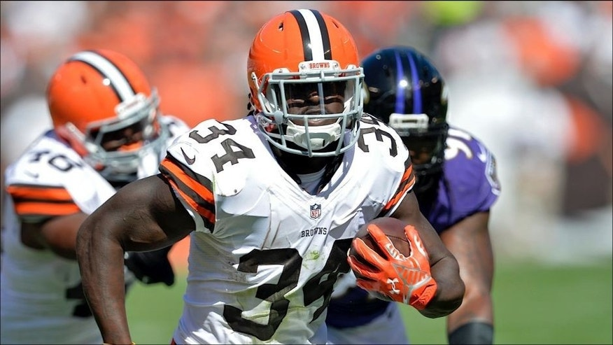 <p>Cleveland Browns running back Isaiah Crowell (34) runs 14 yards for a touchdown against the Baltimore Ravens in the third quarter of an NFL football game Sunday, Sept. 21, 2014, in Cleveland. (AP Photo/David Richard)</p>