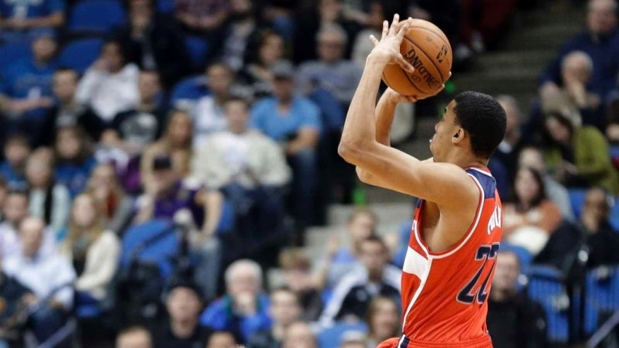 The Washington Wizards' Otto Porter Jr. shoots a jumper against the Minnesota Timberwolves during the first quarter of an NBA basketball game, Friday, Dec. 27, 2013, in Minneapolis.