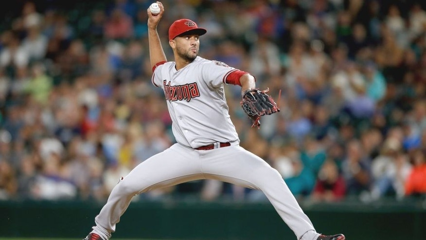 SEATTLE, WA - JULY 27: Relief pitcher Randall Delgado #48 of the Arizona Diamondbacks pitches against the Seattle Mariners in the eighth inning at Safeco Field on July 27, 2015 in Seattle, Washington. (Photo by Otto Greule Jr/Getty Images)