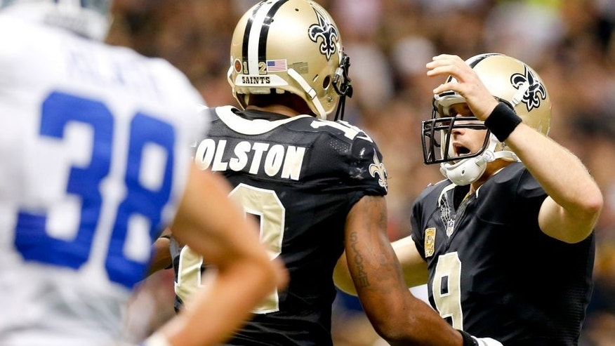 Nov 10, 2013; New Orleans, LA, USA; New Orleans Saints quarterback Drew Brees (9) celebrates with wide receiver Marques Colston (12) after a touchdown during the first quarter of a game against the Dallas Cowboys at Mercedes-Benz Superdome. Mandatory Credit: Derick E. Hingle-USA TODAY Sports