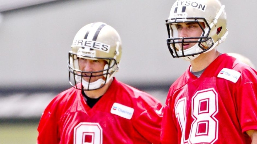 Jun 17, 2015; New Orleans, LA, USA; New Orleans Saints quarterback Drew Brees (9) and rookie quarterback Garrett Grayson (18) during minicamp at the New Orleans Saints Training Facility. Mandatory Credit: Derick E. Hingle-USA TODAY Sports