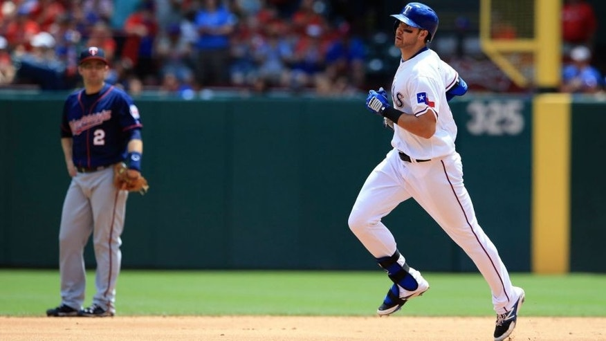 <p>Jun 14, 2015; Arlington, TX, USA; Texas Rangers third baseman Joey Gallo (13) rounds the bases in front of Minnesota Twins second baseman Brian Dozier (2) after hitting a home run during the game at Globe Life Park in Arlington. Mandatory Credit: Kevin Jairaj-USA TODAY Sports</p>