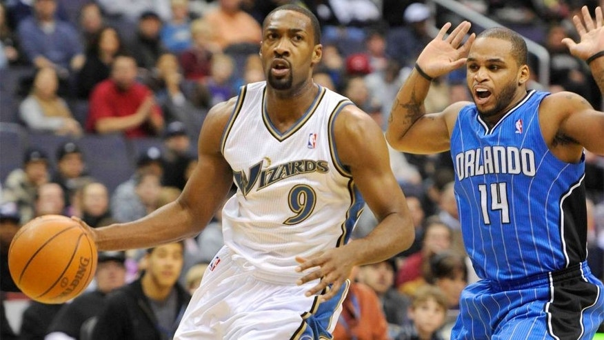 Nov 27, 2010; Washington, DC, USA; Washington Wizards point guard Gilbert Arenas (9) dribbles by and is fouled by Orlando Magic point guard Jameer Nelson (14) during the first half at the Verizon Center. Mandatory Credit: Rafael Suanes-USA TODAY Sports