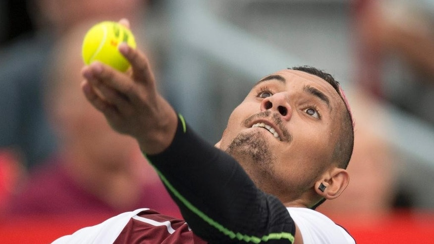 Nick Kyrgios, of Australia, tosses the ball on a serve to Fernando Verdasco, of Spain, at the Rogers Cup tennis tournament Tuesday, Aug. 11, 2015, in Montreal. (Paul Chiasson/The Canadian Press via AP)