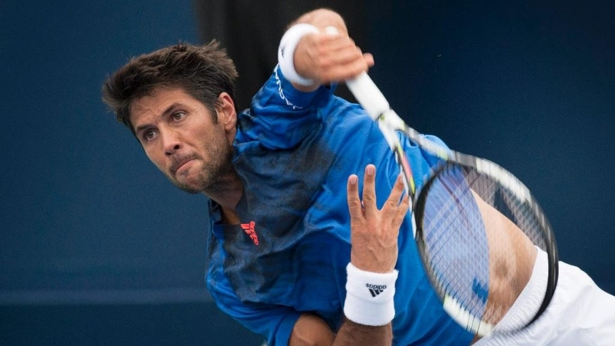 Fernando Verdasco, of Spain, serves to Nick Kyrgios, of Australia, at the Rogers Cup tennis tournament Tuesday, Aug. 11, 2015, in Montreal. (Paul Chiasson/The Canadian Press via AP)