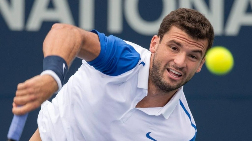 Grigor Dimitrov, of Bulgaria, serves to Alexandr Dolgopolov, of Ukraine,  during first round of play at the Rogers Cup tennis tournament Tuesday Aug. 11, 2015,  in Montreal. (Paul Chiasson/The Canadian Press via AP)