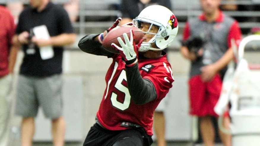 Aug 1, 2015; Glendale, AZ, USA; Arizona Cardinals wide receiver Michael Floyd (15) makes a catch during training camp at University of Phoenix. Mandatory Credit: Matt Kartozian-USA TODAY Sports