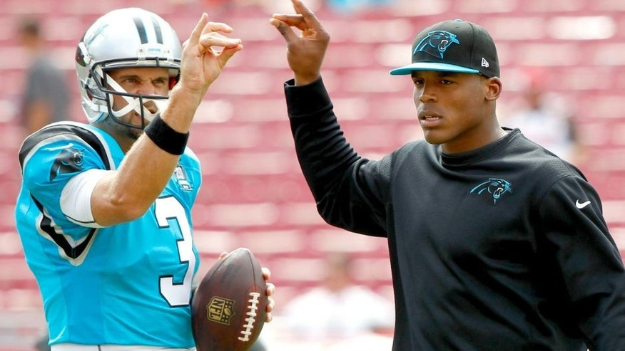 Sep 7, 2014; Tampa, FL, USA; Carolina Panthers quarterback Derek Anderson (3) and quarterback Cam Newton (1) prior to the game against the Tampa Bay Buccaneers at Raymond James Stadium. Mandatory Credit: Kim Klement-USA TODAY Sports