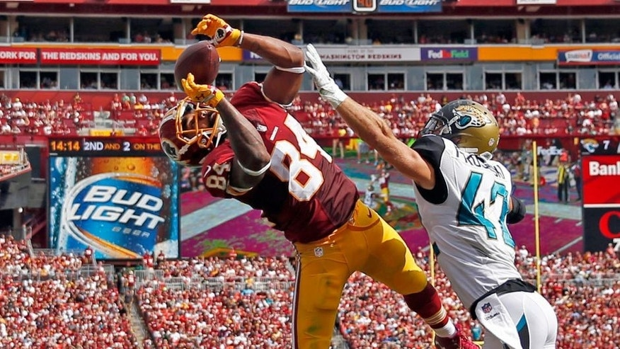 Washington Redskins tight end Niles Paul (84) catches a touchdown pass in front of Jacksonville Jaguars strong safety Chris Prosinski (42) during the second half of an NFL football game Sunday, Sept. 14, 2014, in Landover, Md. (AP Photo/Evan Vucci)